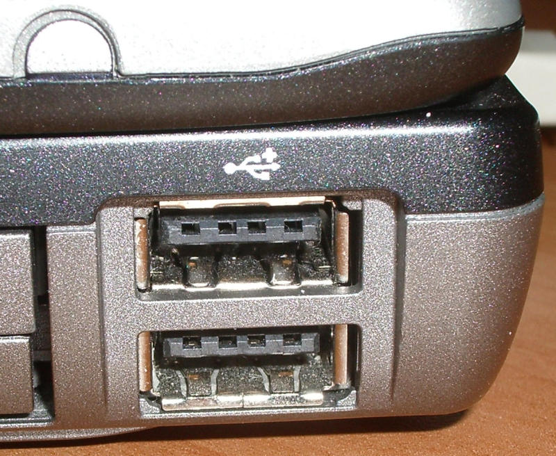 USB ports with four holes in the prong